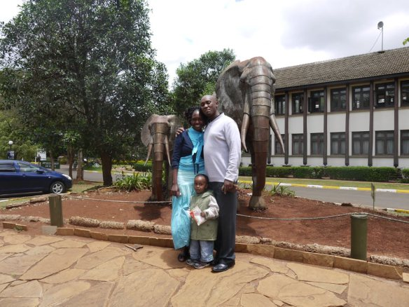 Peter and Debra Gitau, with their son John Paul