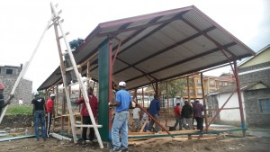 The framing and first installation of the mabati walls.